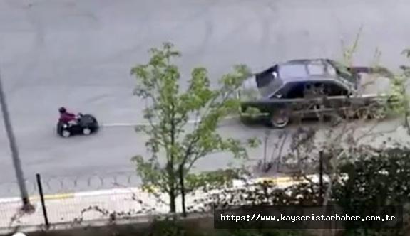 Otomobiline bağladığı aküllü arabayla çocuğunu gezdiren baba yakalandı