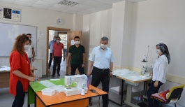 Başkan Altun, maske dikim kursunu ziyaret etti